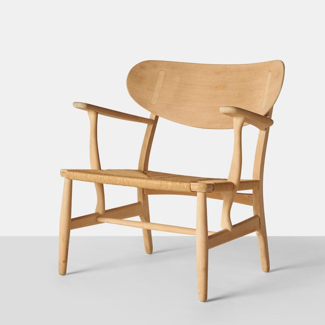 A freshly renovated easy chair by Hans Wegner. Soap treated beech frame and new paper cord seat. Model CH-22, produced by...
