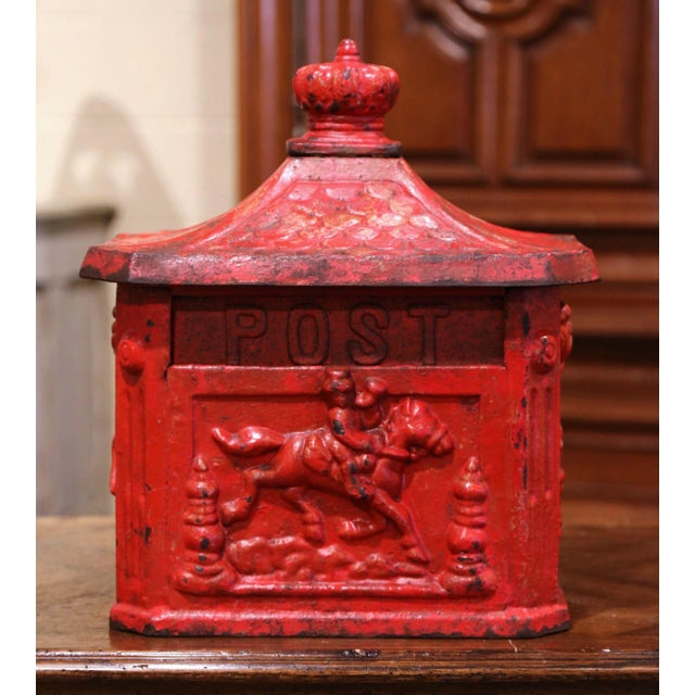 This antique iron mailbox was forged in England, circa 1880. The mail holder features high reliefs decorations on all four...