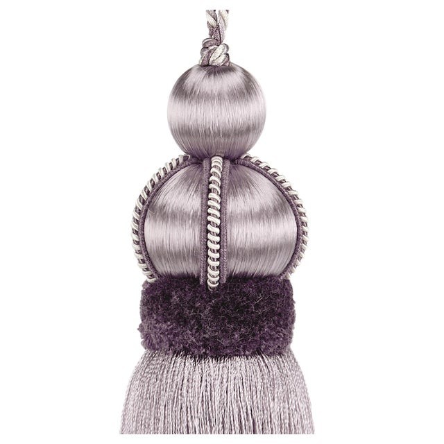 Elegant wisteria/lavender key tassel is connected by a twisted cord that loops over the top. The wood mould is covered...
