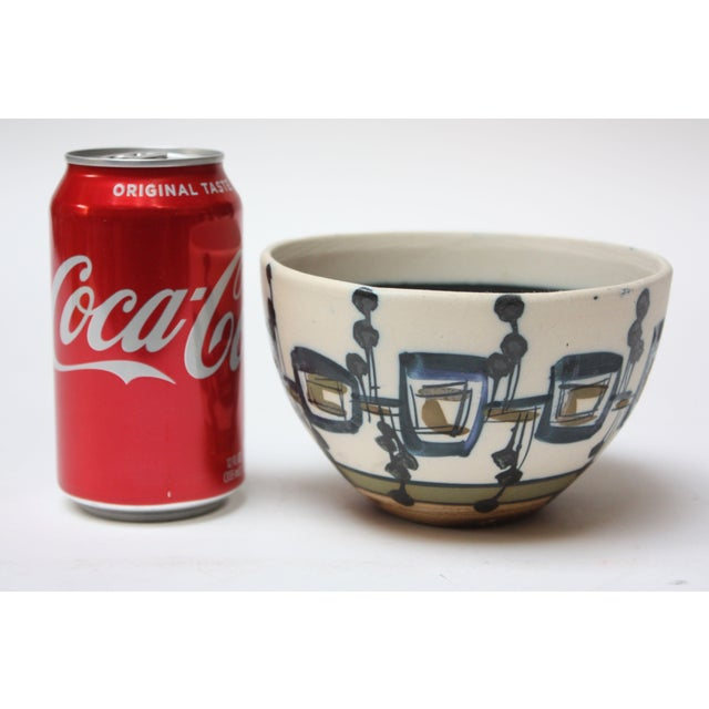 This is an exquisite Israeli ceramic bowl by the Israeli artist, Azaz. It bears the artist's signature in Hebrew, עזז, as...