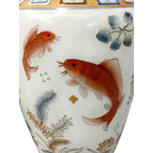 Get your living room's decor swishing in the right direction with the Fish decorated Vases sea weed and long life symbol...