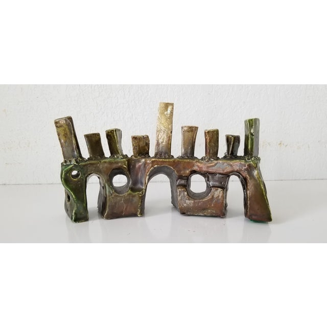 An Impressive Mid-century Handmade Brutalist Abstract Art Pottery Sculptural Menorah . Signed by the artist SDEWITT and...