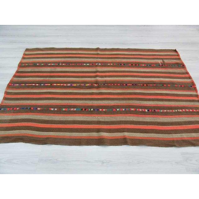 Vintage Brown and Orange Striped Decorative Turkish Kilim Rug - 4′9″ × 7′3″ - Image 3 of 6