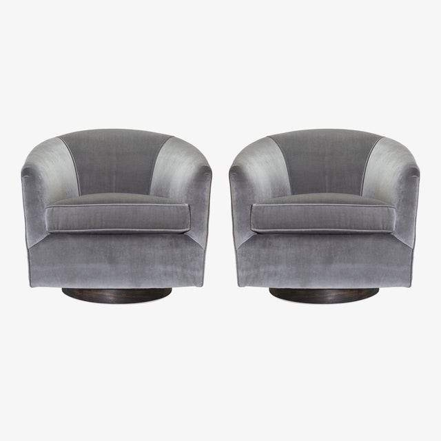 An handsome pair of Mid-Century swivel tub chairs, restored ground up by the Montage Workroom. Swivel chairs are a Mid-...