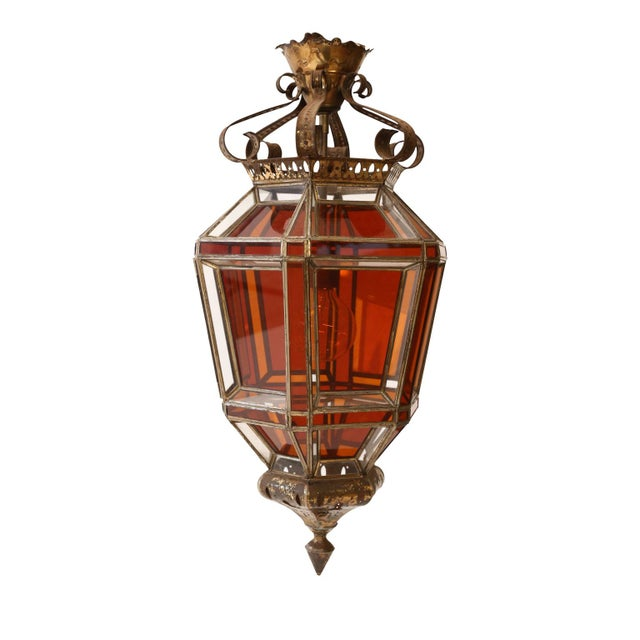 Andalusian amber glass lantern circa 1950-1969, Spain. Single-light naturally-worn silvered tole framed lantern with clear...