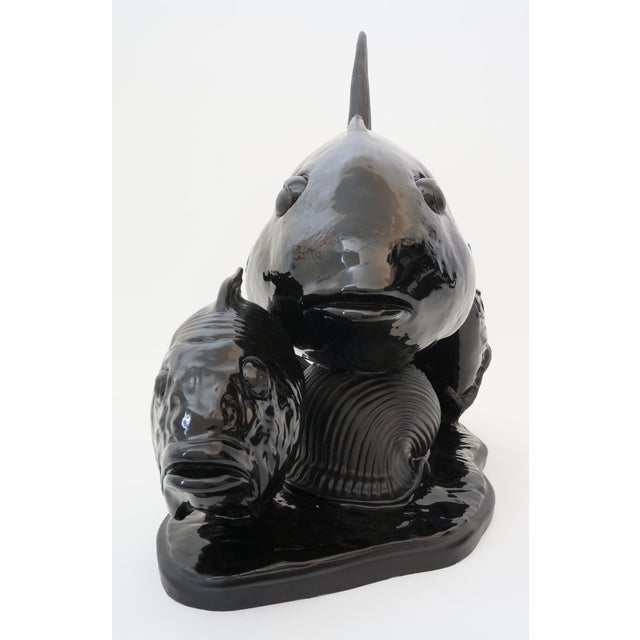 Vintage Art Deco 1930s Lejan Style Sculpture School of Fish in Black Ceramic from a Palm Beach estate Masterful variation...