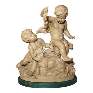Late 19th Century French Terra Cotta Statue of Putti Teasing a Bird Dog For Sale