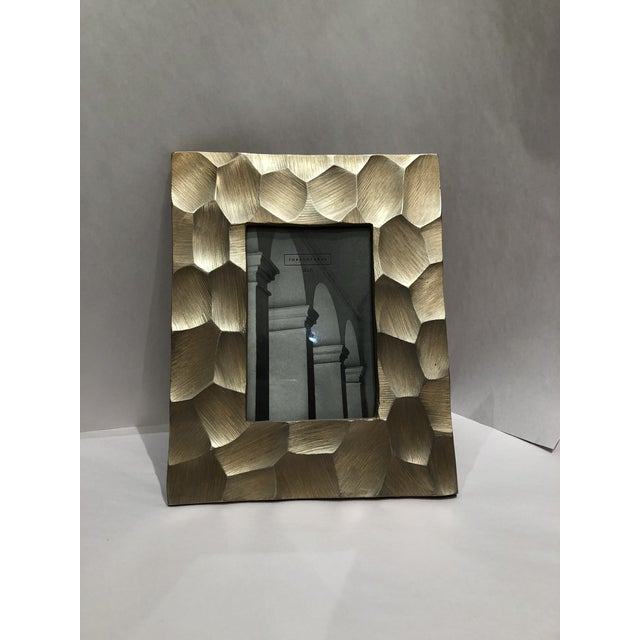 This modern & on trend brushed gold picture frame will compliment many design schemes. The 4x6 frame can be mixed with...
