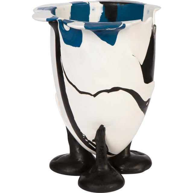 Playful, abstract design vase of cast resin in colors of blue, black and white by architect and designer, Gaetano Pesce....