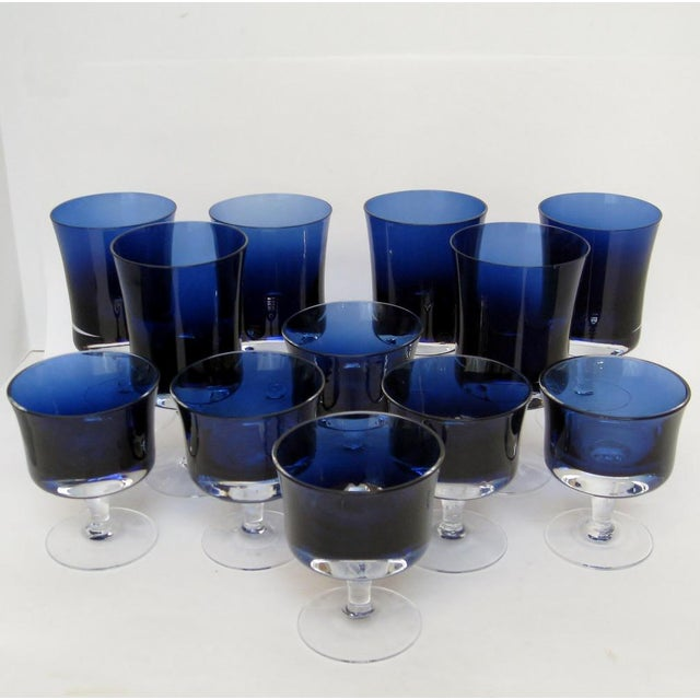 1970s blown glass stemware set by Denby USA, in Mirage-Blue pattern with blue bowls and clear stems. Set includes 6 wine...