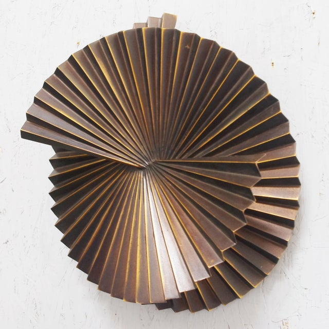 Limited edition pair of medium dark bronzed metal sconces or wall sculptures with spiral fan design / Designed by Fabio...