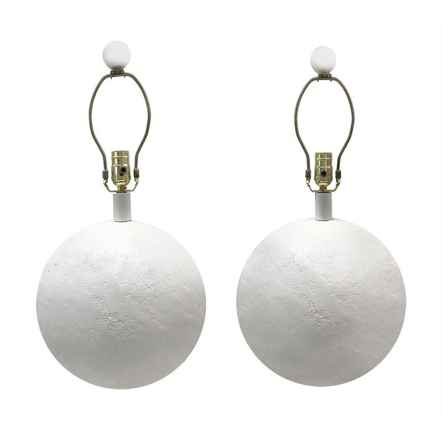 Stylish, large pair of white plaster orb-shaped lamps, c.1970s. Lamps' plaster finish has been newly cleaned. Plaster...