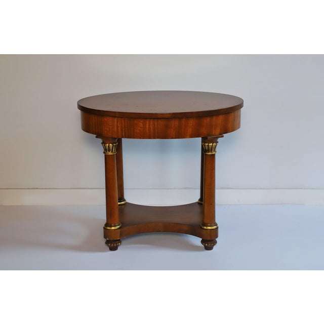 Pair of Empire end tables with gilt details from Henredon acquired from the famed Waldorf Astoria hotel in New York City....