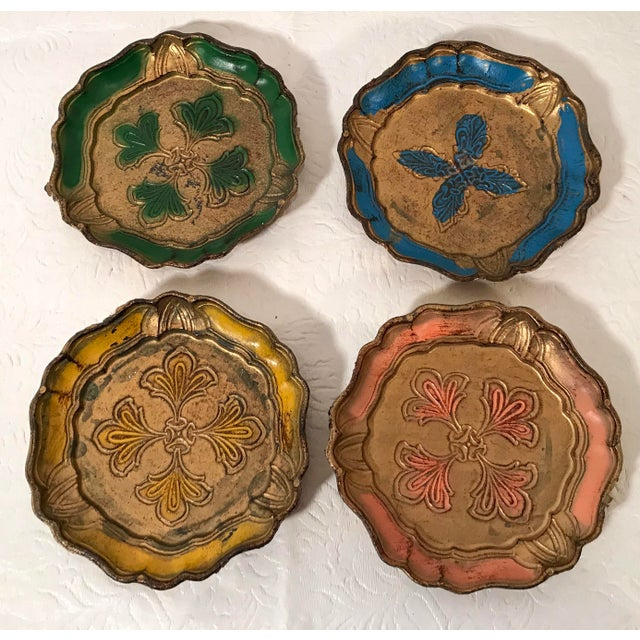 Nice set of four Italian Florentine coasters. These appear to have a plastic coasting on them.