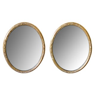 An Elegant Pair of French Napoleon III Carved Giltwood Oval Mirrors For Sale