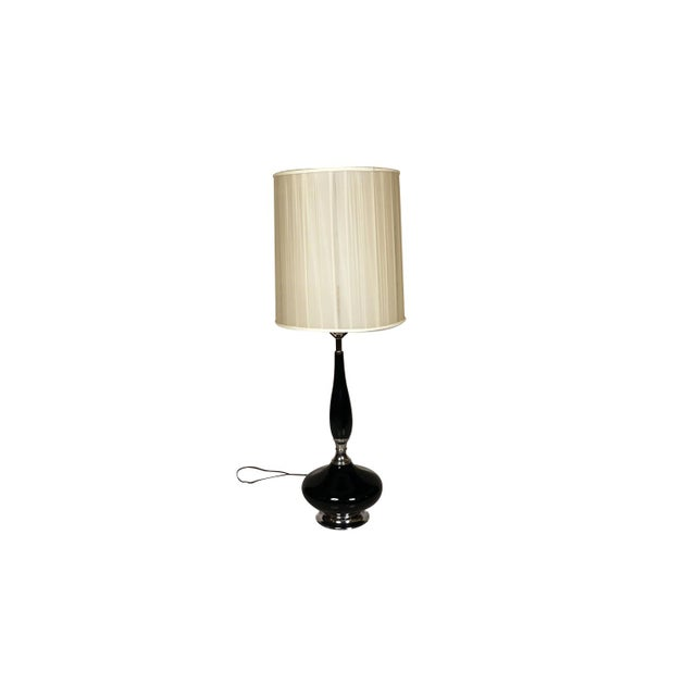 This is a stunning and very sought-after mid century, Hollywood Regency, ceramic table lamp with an elongated neck, over...