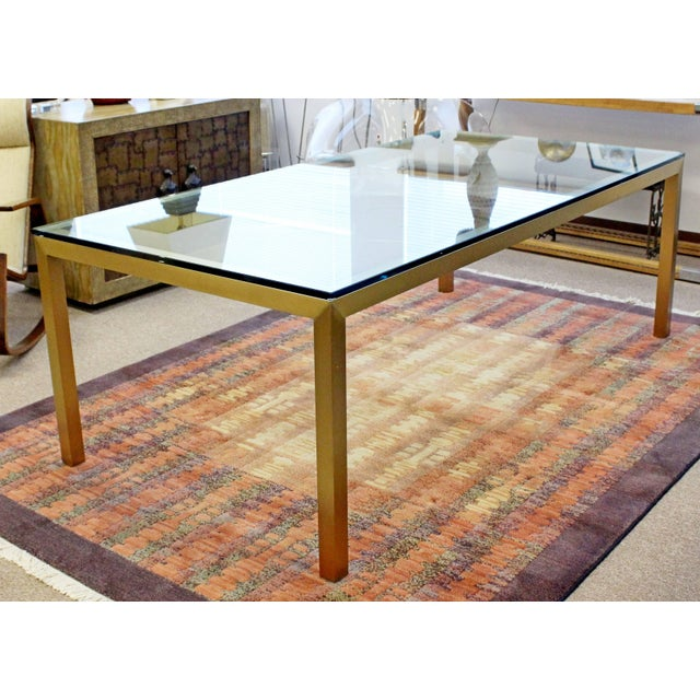 For your consideration long, luxe, bronze and glass, dining table by Brueton . In excellent condition. The dimensions are...