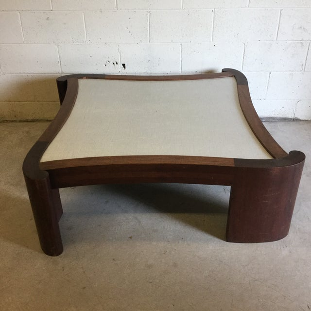 Very unusual walnut coffee table with laminate top. Not sure if there was another surface on top, because the laminate...