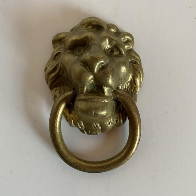 Pair of vintage cast brass lion head drop pulls. Perfect for a vintage dresser or cabinet. Single hole. Furniture screws...