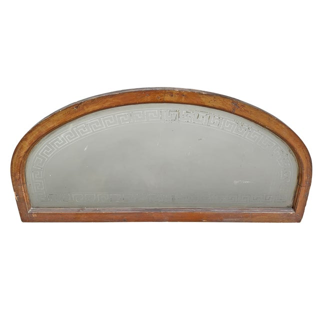 A marvelous late 19th century American arch top transom window with a hand-etched greek key pattern framing a frosted...