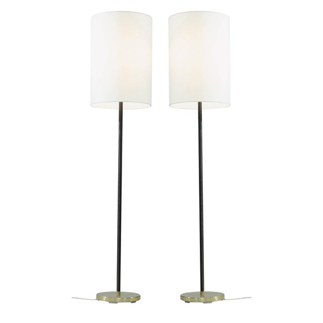 A luxurious yet minimalist floor lamp by J.T. Kalmar, Austria, with a heavy brass and leather covered stem and a white...