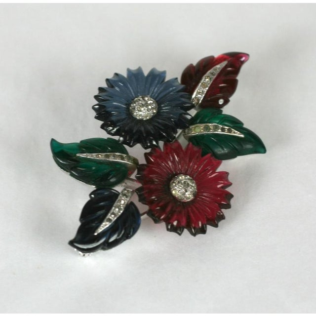 Mazer pave and tricolor faux gemstone fruit salad flower and leaf spray. Set in rhodium plated base metal with crystal...