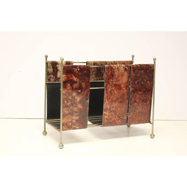 Italian Aldo Tura Mid-Century magazine rack made of lacquered leather with metal base.