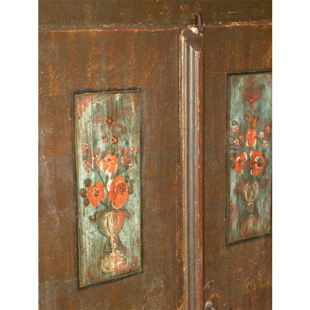 Swiss marriage armoire circa 1840 Condition: Overall wear with restoration to painting. Shelves on the left side are...