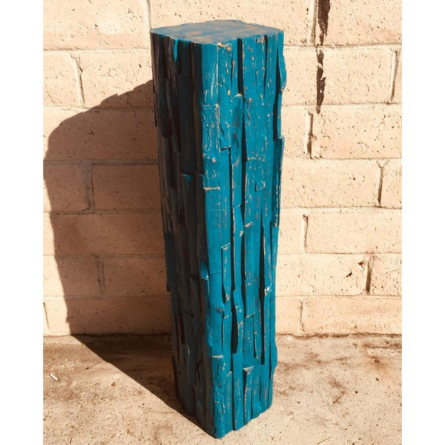 The reclaimed wood pedestal adds a nice touch to any setting be it contemporary or rustic. It makes a wonderful plant...