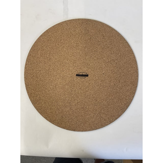 Round placemat in wood fiber and back in natural cork . Non Stain Handmade in Italy Material: Laminated top (fiber) and...