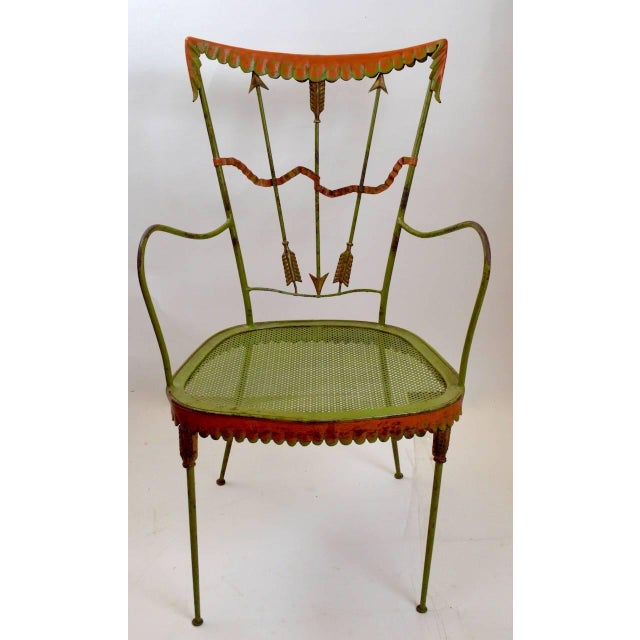 Rare armchair version of the classic wrought iron garden chairs by Tomaso Buzzi. Measure: Arm height 24.75 inches, seat...