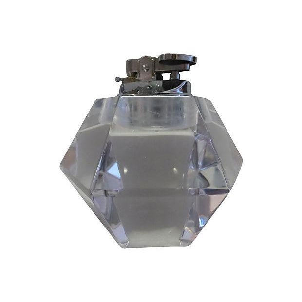 12-facet cut glass table light with a chrome insert to hold the lighter. Uses regular lighter fluid. Light wear.