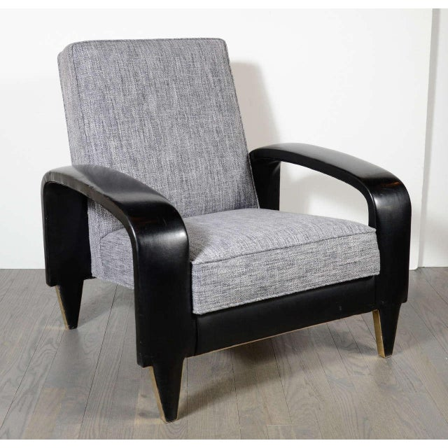 This rare Art Deco club chair features sculptural banded upholstered leather arms and new woven grey and pearl tweed...