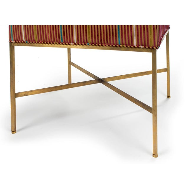 A pair of benches with square seats supported by a slim brass frame with square legs and X-stretcher. Model no. 1306. By...