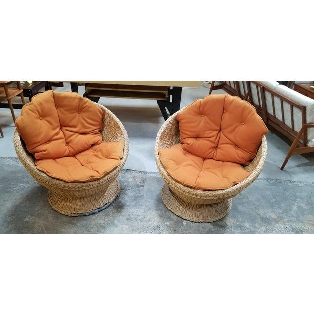 "1970's Mod rattan / wicker ""Pod"" lounge chairs with original, reversible cushions. Sturdy construction. Cushion foam soft..."