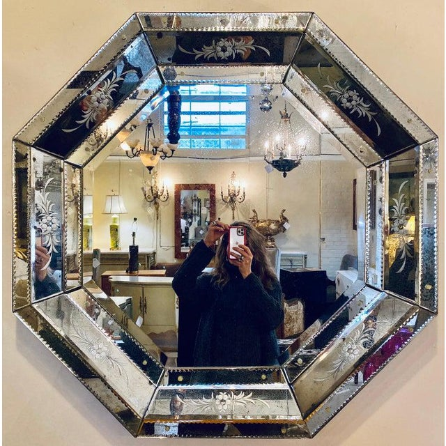 Venetian style Hollywood Regency octagon mirror. These beautifully etched glass antiqued framed mirrors having several...
