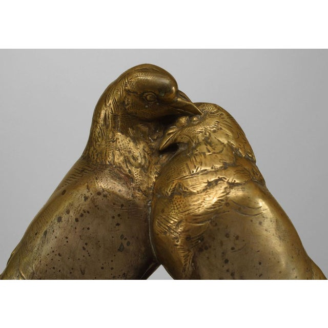 Art Deco bronze figure of two pigeons necking on beige marble base (signed in marble, A. MOULON with Medaille D'Honneur...
