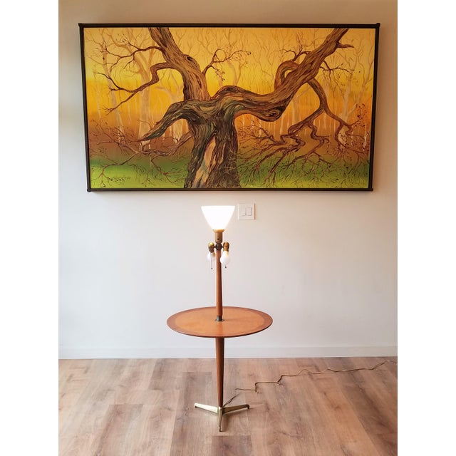 Rare Dunbar floor lamp/snack table combo, Model 5410, designed by Edward Wormley circa 1940s. This stunning table features...
