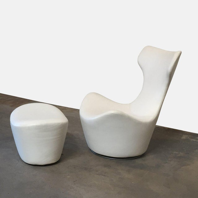 Take the edge off with this sculptural swivel chair and ottoman. Rounded shapes can balance a room with too many hard...