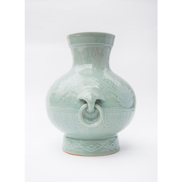 Wondefully ornate Chinese porcelain vase with elephant ring pull detail, finished in a celadon glaze. 1960's vintage and...