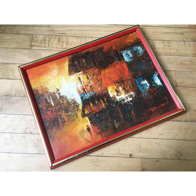 Vintage abstract cityscape composed of vibrant colors, and framed by a bright red and brass frame. Signed by American...