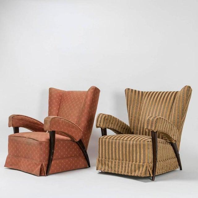 Remarkable set of two Italian 1950s bergères. Upholstered armrests and sleek wood frame.