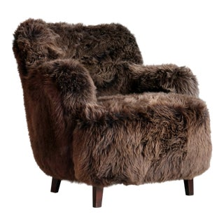 Fritz Hansen Style Danish 1950's Lounge Chair Covered in Icelandic Sheepskin For Sale