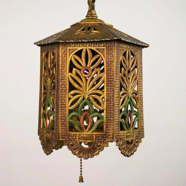 This charming 1930's American polychrome cast metal reticulated lantern is perfect for any bungalow or hallway, closet or...