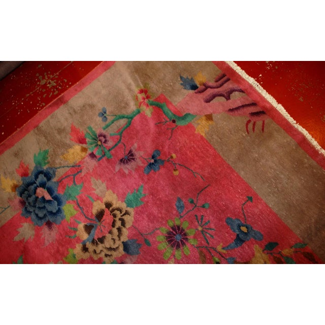 This is an antique Art Deco Chinese wool rug in original condition. The rug is in pink color with a beige border. It...