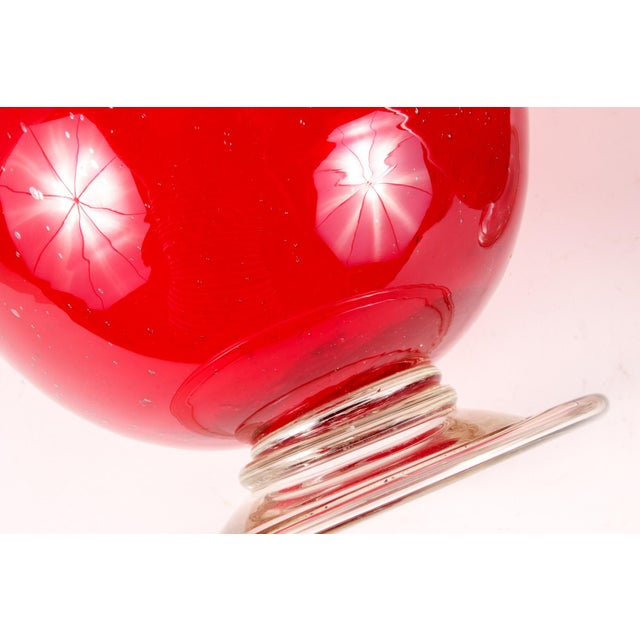 A substantial pair of cranberry colored bubble glass Hurricanes or vases, perfect for your Holiday Table. Outstanding...