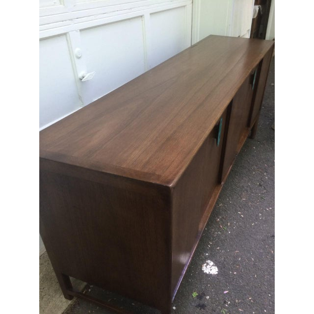 Unique credenza / buffet / sideboard / dresser with very subtle curved front and slightly tapered top. Designed by Ray...