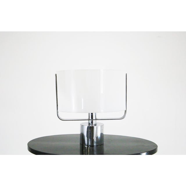 jacques quinet , 70s table lamp in plexiglass and chrome steel. The lamp is fully functional with 1 light. in excellent...