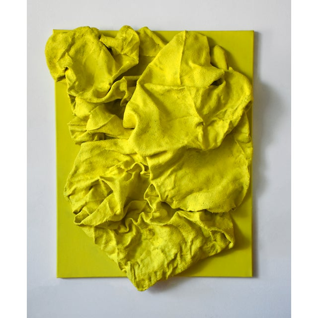 """Lemon Yellow Folds"" is a mixed media wall sculpture made with burlap and paint on linen. The elegant folds are studiedly..."