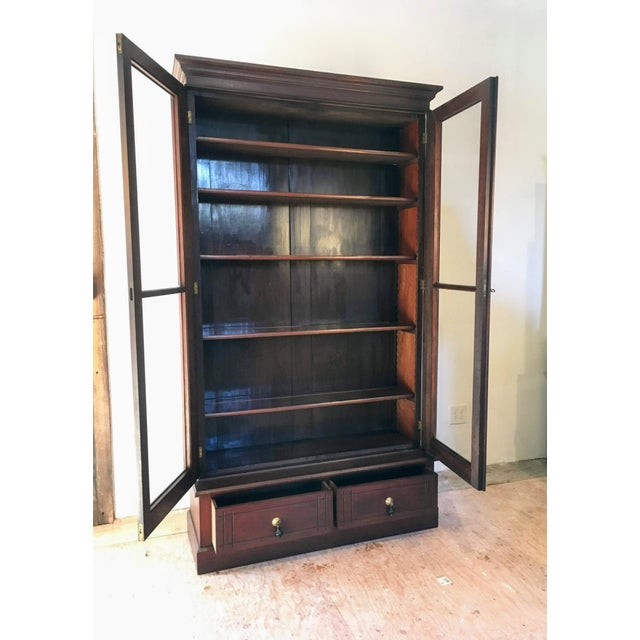 A lovely Victorian two door bookcase or display cabinet. The double glass doors do lock, though no key is included; the...